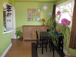 Enchanting Green Wall Color Completed With Dining Room Decor Also Black Chairs