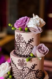 Round Cake Decorated With Piping And Fresh Roses