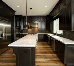 black kitchen cabinets wood floor wood floors in the kitchen