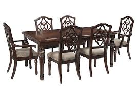 Leahlyn Reddish Brown Rectangular Dining Room Extension Table W 4 Side ChairsSignature Design