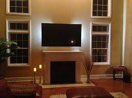 modern black wide screen tv on light brown wall panel with led