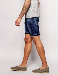 asos denim shorts in extreme super skinny fit with raw hem in blue
