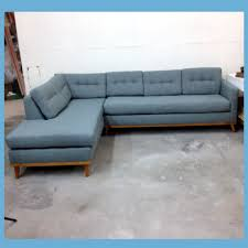 living room della left sectional sofa with storage ottoman in