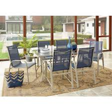 Cosco Paloma 7-Piece Tempered Glass Table Top Outdoor Dining Set With Sand  Frame And Navy Sling Chair