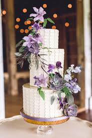 The contrast between the light and dark purple appears incredible with the white and ultra modern buttercream frosting wedding cake