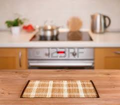 fond de cuisine wooden table on defocused kitchen bench background stock photo