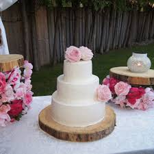 3 Tier Buttercream Rustic Garden Wedding Cake With Fresh Pink Roses On Central