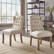 Shop Portia Tufted Wingback Dining Chair With Nailhead Trim By ... Wingback Ding Chair White And Gray Roundhill Button Tufted Solid Wood Hostess Chairs With Amazoncom Lazymoon Beige Pattern New Pacific Direct Inc Aaron Upholstered Parson Nailhead Trim With Msp Design Show How To Recover A Richmond Vintage Tan Leather Zin Home Nail Head Accent Ramalanco Homespot Archie Pu Velvet Set Of 2