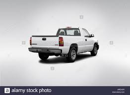 2006 GMC Sierra 1500 WT In White - Rear Angle View Stock Photo ... 2006 Gmc Sierra 1500 Crew Cab Pickup Truck Item Da5827 S C6500 Topkick Crew Cab 72 Cat Diesel And Chassis Truck Gmc 5500 At235p Bucket 3500 Slt 4x4 Dually In Onyx Black 252013 Biscayne Auto Sales Home 2gtek13t461226924 Green New Sierra On Sale Ga Awd Denali 4dr 58 Ft Sb Research Truck For Classiccarscom Cc1041428 Yukon Denali Loaded Tx Lthr Htd Seats Clean 2500 With Salt Spreader Western Plow Plowsite