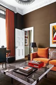 brown living room with orange sofa living room design ideas