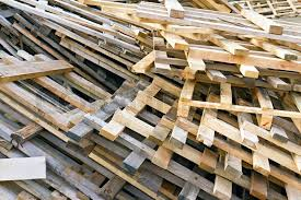 Background Of Piled Up In A Pile Wooden Pallets