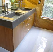 grey undermount double trough sink and steel faucet over brown