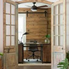 Rustic Brown Home Office With Barn Door Style Window Treatment