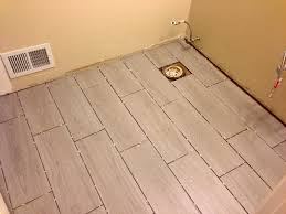 Cut Laminate Flooring With Miter Saw by Aimlessly Elegant Bathroom Remodel Floor Tile