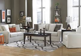 Exciting Lowes Rug On Cozy Wood Flooring And Rustic Coffee Table Plus White Loveseat