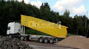 Yellow Dump Truck Unloading Soil In The Site: Royalty-free Video And ...