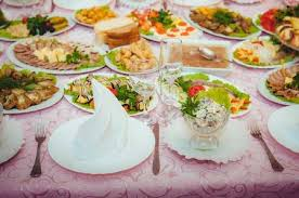 Decorated Table By The Window In Dining Room With Dishware And Tasty Food