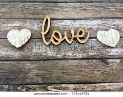 Love Wooden Word Letters On Rustic Background And Bark