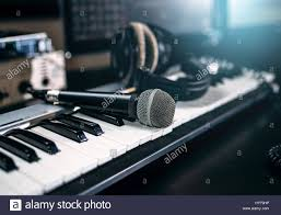 Professional Music Studio Equipment Closeup Musical Keyboard Microphone And Headphones Audio Recording Tools
