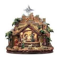 Thomas Kinkade Christmas Tree Cottage by Amazon Com Thomas Kinkade Following The Star Nativity Sculpture