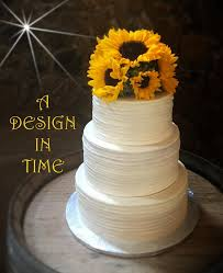 RUSTIC SUNFLOWER CAKE WITH MINI BRIDE AND GROOM