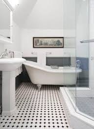 diy bath renovation from dated to sophisticated black tiles