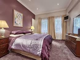 Master Bedroom Soft Purple Accent Wall Color With Beige Curtain For Within