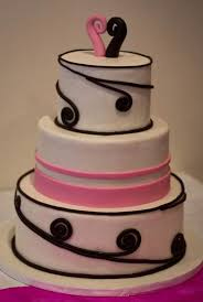 Three tier round modern white wedding cake with pink accent and pink and black wave toppers JPG