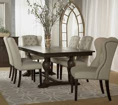 Exclusive White Tufted Cowhide Dining Chair With Orchid On The Wooden Table Arch Entrance
