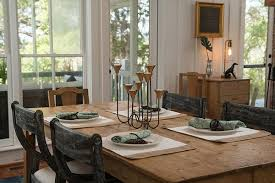 Decorate Your Dining Room With A Simple Rustic Wood Table And Contrasting Wooden Chairs