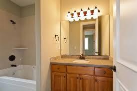 Chandelier Over Bathroom Vanity by Bathroom Contemporary Classic Bathroom Lighting Idea With Gold