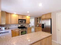granite with light cabinets light and bright the kitchen has