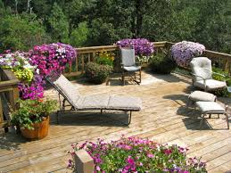Wooden Planters Using Purple Flowers For Modern Garden Ideas With Rustic Deck And Comfortable Lazy Chairs