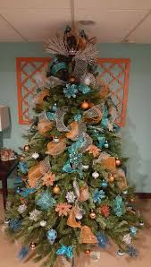 Teal And Orange Mesh Ribbons An Interesting Color Combination Of Blue Flowers Makes This A Distinctive Christmas Tree