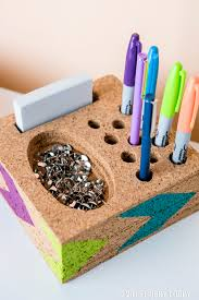 build a desk catchall by cutting cork tiles one at a time to fit