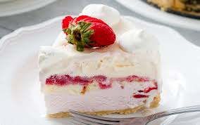 slice of Strawberry Shortcake Ice Cream Cake topped with a strawberry