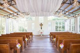 The Chapel Was Decorated With Daisy Aisle Markers A Floral Cross Sheer Draping