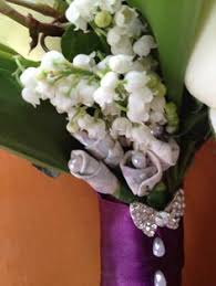 Purple orchid bouquet with feathers brooch and bling