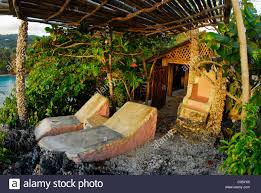 Fig Tree House Hut At Great Huts, An Eco-resort Village Of Stock ... Tiki Hut Builder Welcome To Palm Huts Florida Outdoor Bench Kits Ideas Playhouse Costco And Forts Pdf Best Exterior Tiki Hut Cstruction Commercial For Creating 25 Bbq Ideas On Pinterest Gazebo Area Garden Backyards Impressive Backyard Patio Quality Bali Sale Aarons Living Custom Built Bars Nationwide Delivery Luxury Kitchen Taste Build A Natural Bar In Your For Enjoyment Spherd Residential Rethatch
