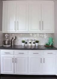 Backsplash Ideas With White Cabinets by Marble Herringbone Backsplash Kitchen Floating Shelves Nina