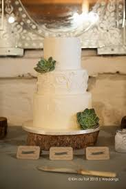 All White Wedding Cake With Succulents