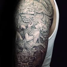 Guy With Stone Mayan Themed Half Sleeve Tattoo