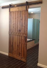 Rustic Brown Sliding Barn Door For Nice Bathroom With Nail Trim Accent Also Black Metal Rod Plus Ceramic Tile Floor Ideas