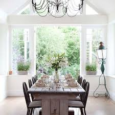 The Design Ideas Of Cozy Dining Room With Long Wooden Table Conservatory