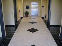 flooring vct tile with toilet seat and tile wall for bathroom design