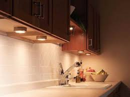 task lighting installed in the kitchen cabinets interior