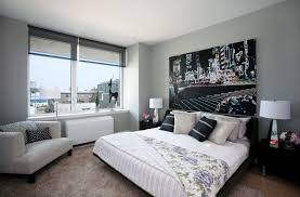 White Covered King Size Bed With Grey Windows Shade And Modern Accent Chairs As Inspiring Open Views Bedroom Decorating Ideas