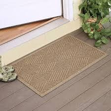 Andersen Waterhog Floor Mats by Flooring Entrance Floor Mats In Brown With Decorative Plant On