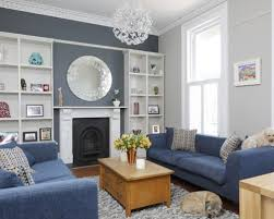 Elegant Formal Medium Tone Wood Floor Living Room Photo In Gloucestershire With A Standard Fireplace