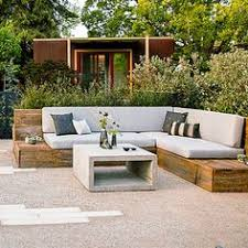 a patio with two sofas and a table in black brown plastic rattan